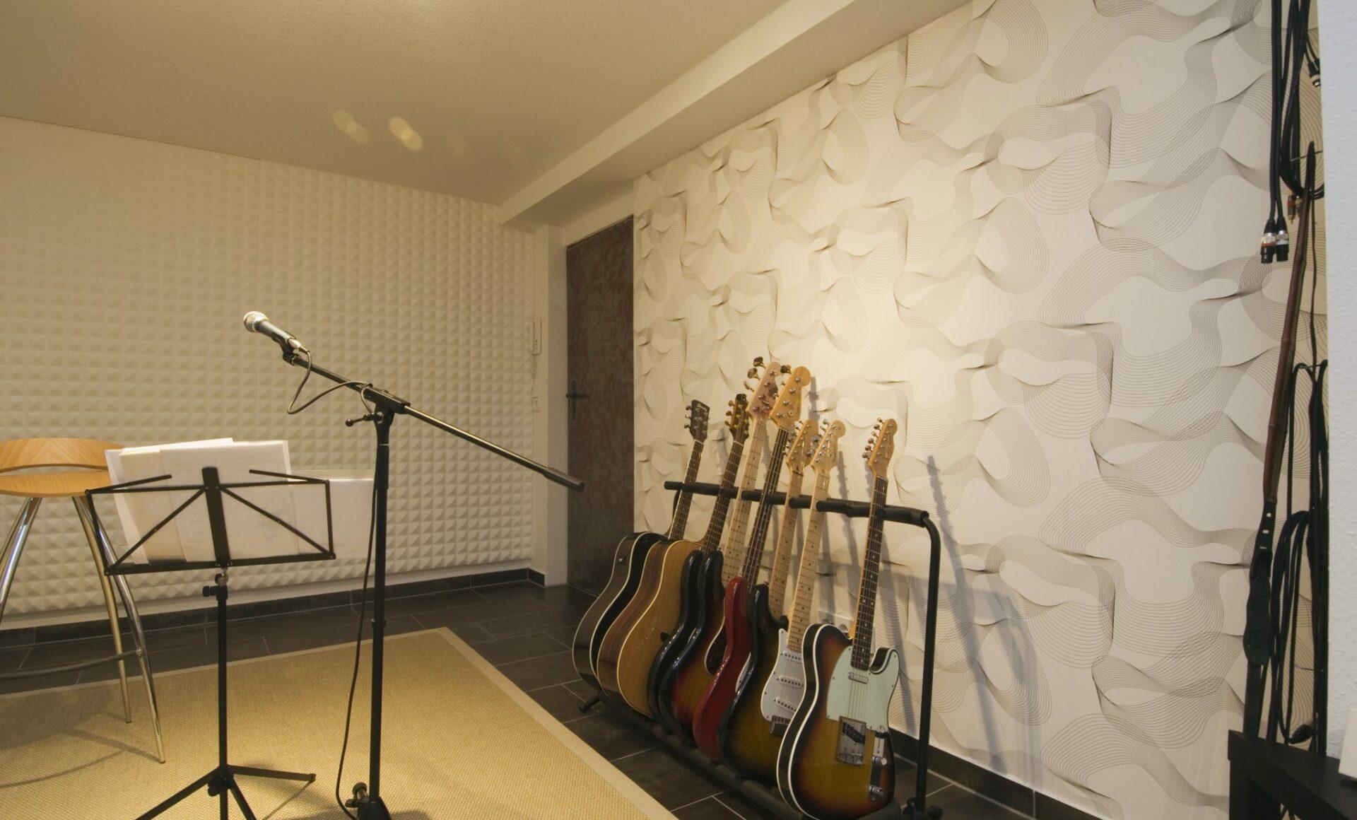 Musikzimmer Akkustikwand Gitarre